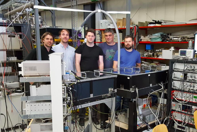 The team of researchers from PTB and LMU during research work in the Maier-Leibnitz Laboratory of LMU and Technical University of Munich (TUM) in Garching near Munich. From left to right: Lars von der Wense, Benedict Seiferle, Johannes Thielking, Maxim V. Okhapkin, Przemysław Głowacki*. (PTB- Physikalisch-Technische Bundesanstalt Braunschweig, LMU - Ludwig Maximilian University in Munich, *currently PUT - Poznan University of Technology). Photo: P. Głowacki