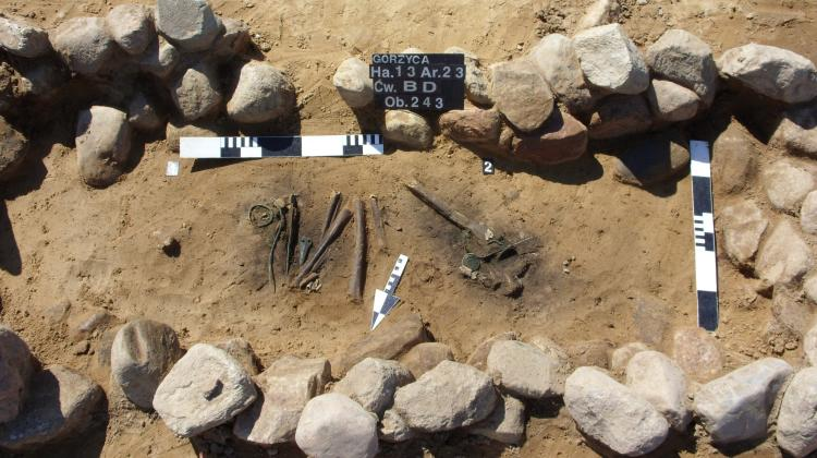 Archaeologists in the course of documenting one of the discovered graves. Photo by K. Socha