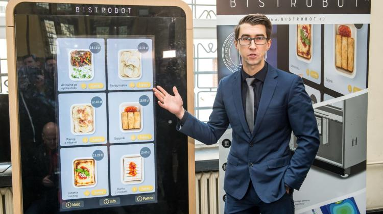 Project coordinator Wojciech Jopek presents Bistrobot - a machine that serves hot meals - at Wrocław University of Technology. The machine is the work of Food Robotics, a company founded by students and graduates of Wrocław University of Technology. Photo: PAP/Maciej Kulczyński  5.01.2018