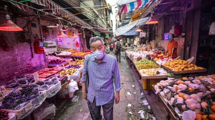 "Man at a ""wet market"" in Guangzhou, Guangdong province, China, April 20, 2020. EPA/ALEX PLAVEVSKI"