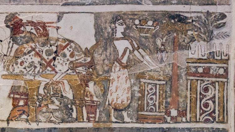 The unique depiction on the Hagia Triada sarcophagus has been reinterpreted by researchers as ritual washing of hands after sacrificing a bull. The fragment shows a priestess washing her hands in a wide bowl after making an offering of a bull. Credit: ArchaiOptix. Shared under an Attribution-ShareAlike 4.0 International (CC BY-SA 4.0) license.