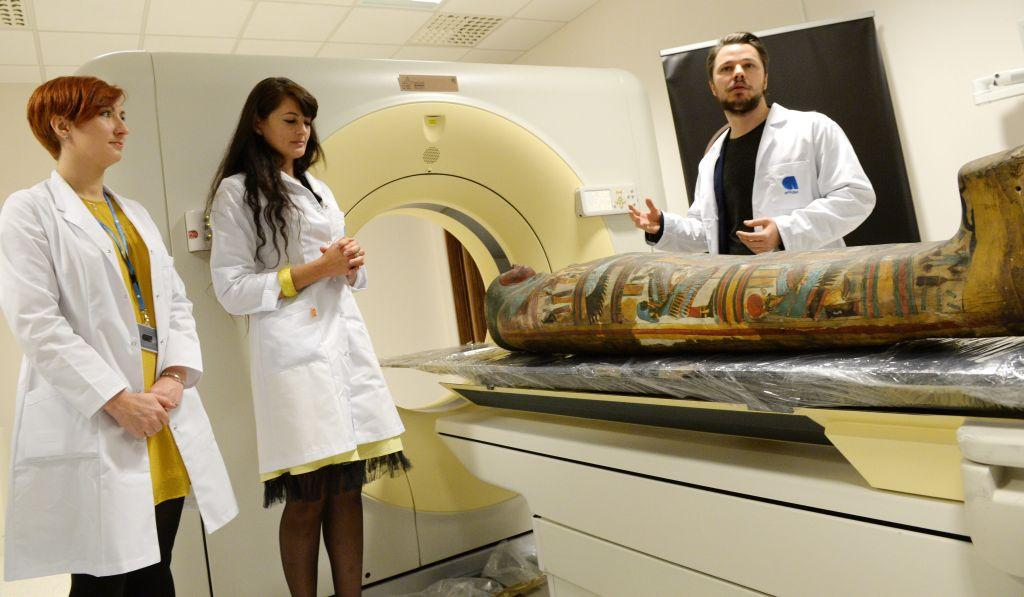 Marzena Ożarek-Szilke (L), Kamila Braulińska (2L) and Wojciech Ejsmond (R) during a press conference on the Warsaw Mummy Project in Otwock. In the project, researchers will study more than 40 ancient mummies of humans and animals. The study will provide a chance of finding traces of diseases occurring in antiquity. Photo: PAP/Jacek Turczyk 15.12.2015